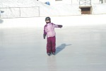 a photo of a student skating at the rink